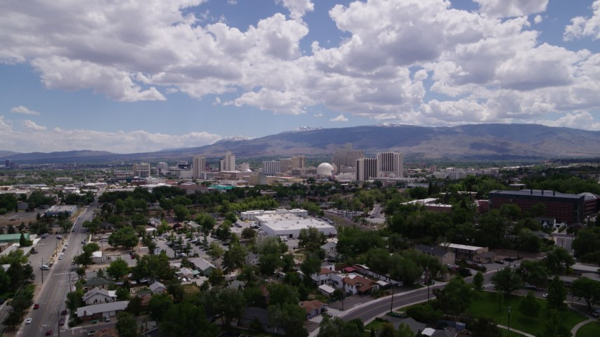 5.7K stock footage aerial video of a view of hotels and casinos seen from north of the city in Reno, Nevada Aerial Stock Footage | DX0001_000021