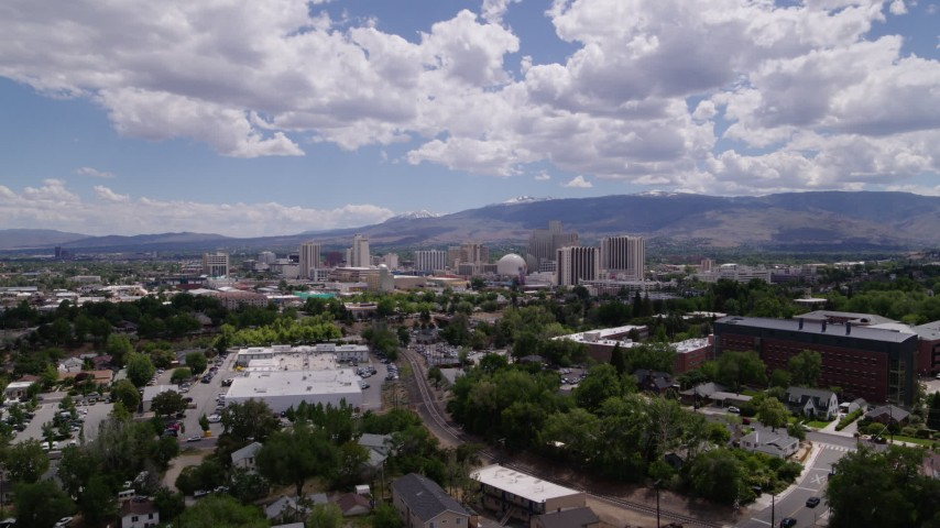 5.7K stock footage aerial video of hotels and casinos seen while descending north of the city in Reno, Nevada Aerial Stock Footage | DX0001_000023