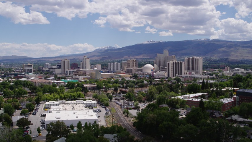 5.7K stock footage aerial video of hotels and casinos seen while passing north of the city in Reno, Nevada Aerial Stock Footage | DX0001_000024