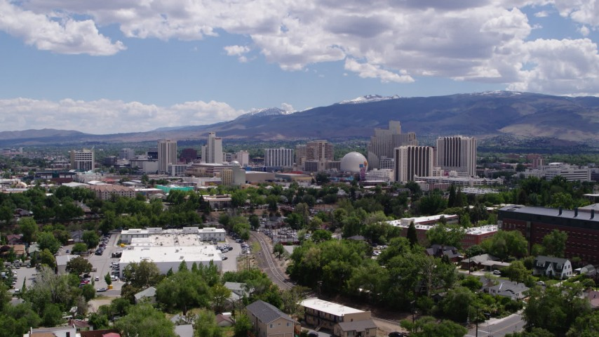 5.7K stock footage aerial video of a reverse view of hotels and casinos of the city's skyline in Reno, Nevada Aerial Stock Footage | DX0001_000028