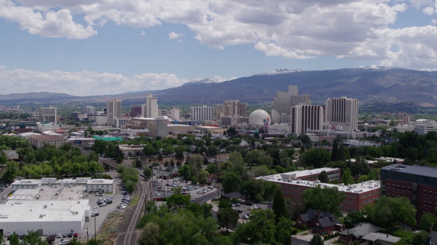 5.7K aerial video of passing the hotels and casinos in the city's skyline in Reno, Nevada Aerial Stock Footage   DX0001_000032