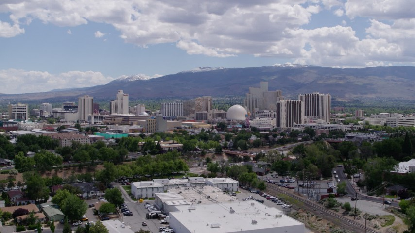 5.7K stock footage aerial video of flying by the hotels and casinos in the city's skyline in Reno, Nevada Aerial Stock Footage | DX0001_000033