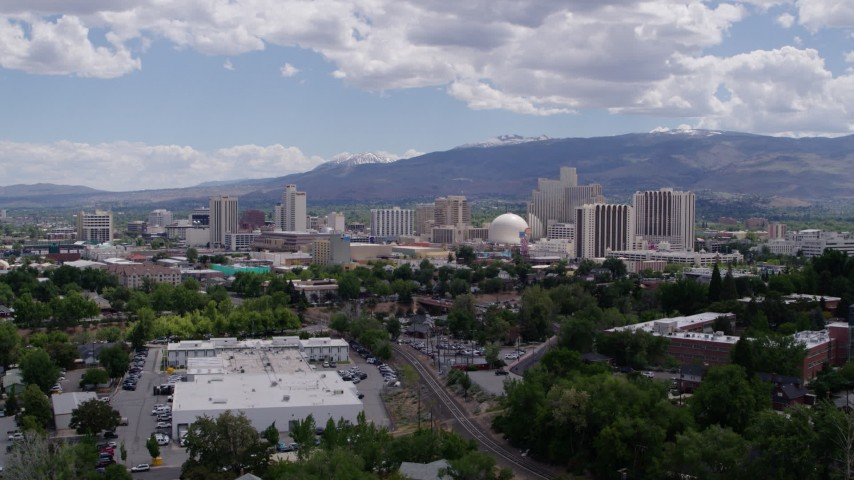 5.7K stock footage aerial video of descending with a view of the hotels and casinos in the city's skyline in Reno, Nevada Aerial Stock Footage | DX0001_000035