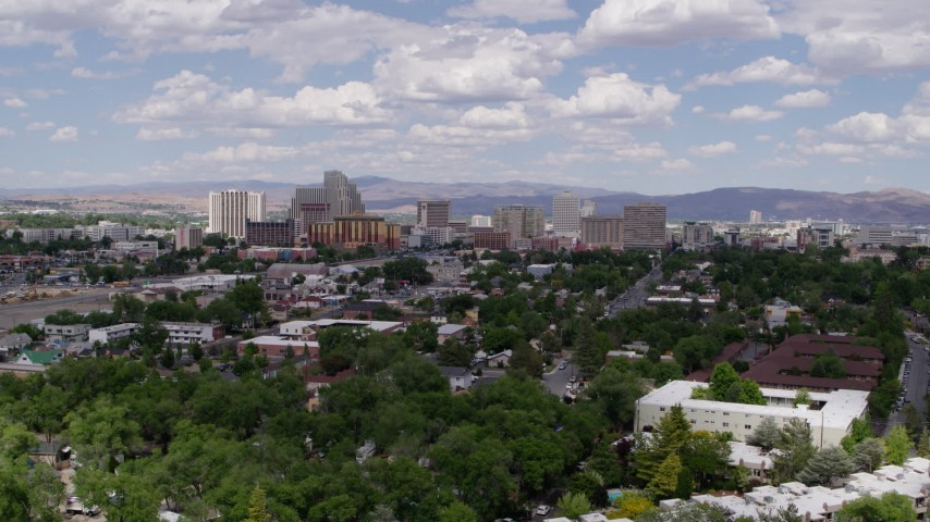 5.7K stock footage aerial video of flying by the city's skyline, seen from west of the city in Reno, Nevada Aerial Stock Footage   DX0001_000038