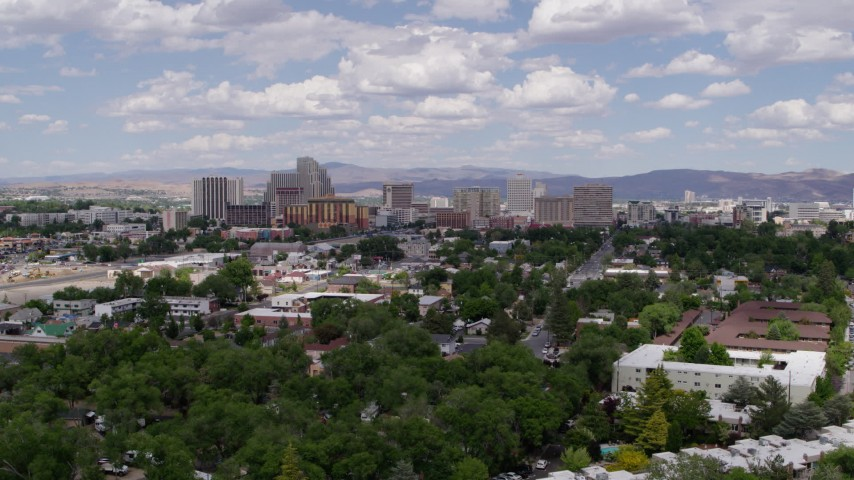 5.7K stock footage aerial video of hotels and casinos of the city's skyline, seen while descending west of the city in Reno, Nevada Aerial Stock Footage   DX0001_000041