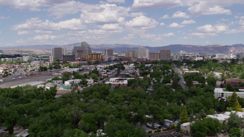 5.7K stock footage aerial video flyby hotels and casinos of the city's skyline, and descend toward the trees in Reno, Nevada Aerial Stock Footage | DX0001_000043