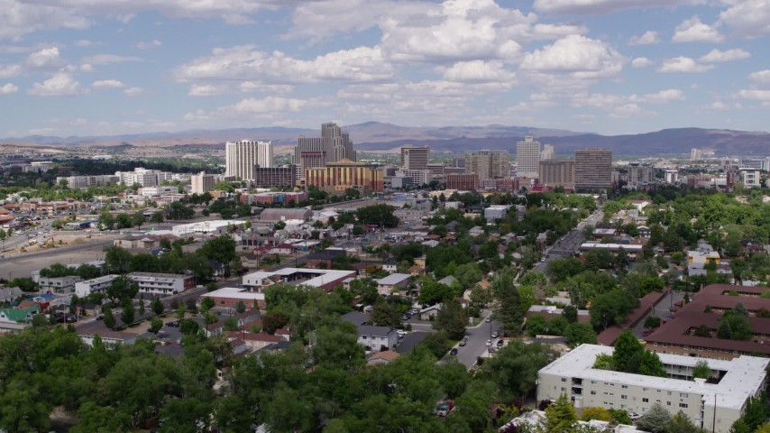 5.7K stock footage aerial video of a reverse view of hotels and casinos of the city's skyline in Reno, Nevada Aerial Stock Footage | DX0001_000046