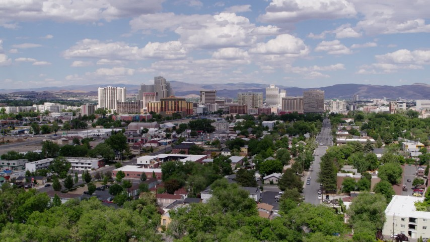 5.7K stock footage aerial video of a reverse view of the hotels and casino resorts of Reno, Nevada Aerial Stock Footage | DX0001_000052