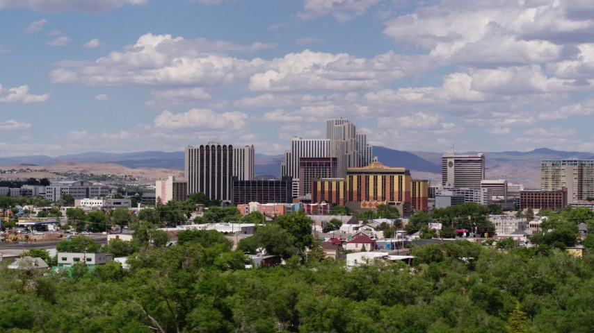 5.7K stock footage aerial video of flying by a group of hotels and casino resorts in Reno, Nevada Aerial Stock Footage | DX0001_000058