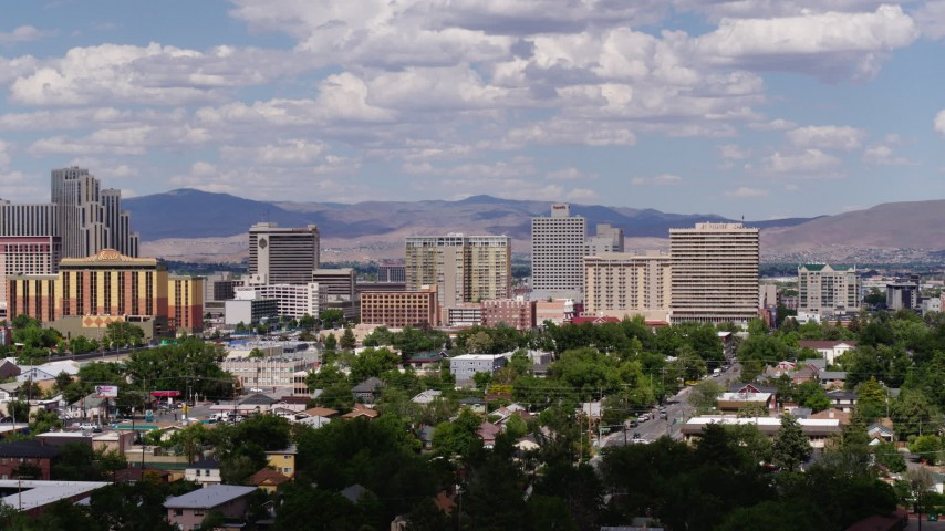 5.7K stock footage aerial video of passing the casino resorts of Reno, Nevada Aerial Stock Footage | DX0001_000060