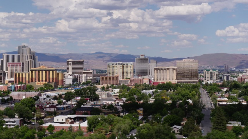5.7K stock footage aerial video of passing a group of casino resorts of Reno, Nevada Aerial Stock Footage | DX0001_000061