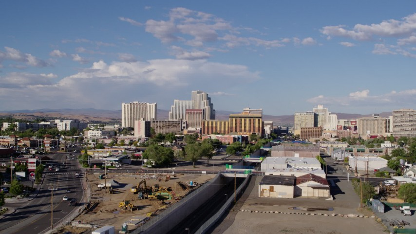 5.7K stock footage aerial video of following train tracks toward casino resorts in Reno, Nevada Aerial Stock Footage | DX0001_000062