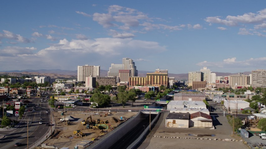 5.7K aerial video of a reverse view of train tracks leading to casino resorts in Reno, Nevada Aerial Stock Footage   DX0001_000063