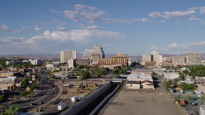 5.7K stock footage aerial video of following train tracks toward the city skyline in Reno, Nevada Aerial Stock Footage | DX0001_000064