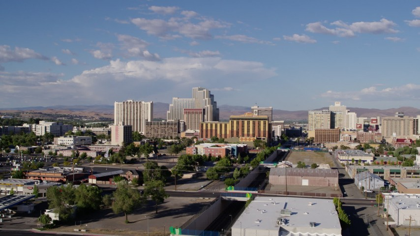 5.7K stock footage aerial video of flying away from train tracks and the city skyline in Reno, Nevada Aerial Stock Footage   DX0001_000067