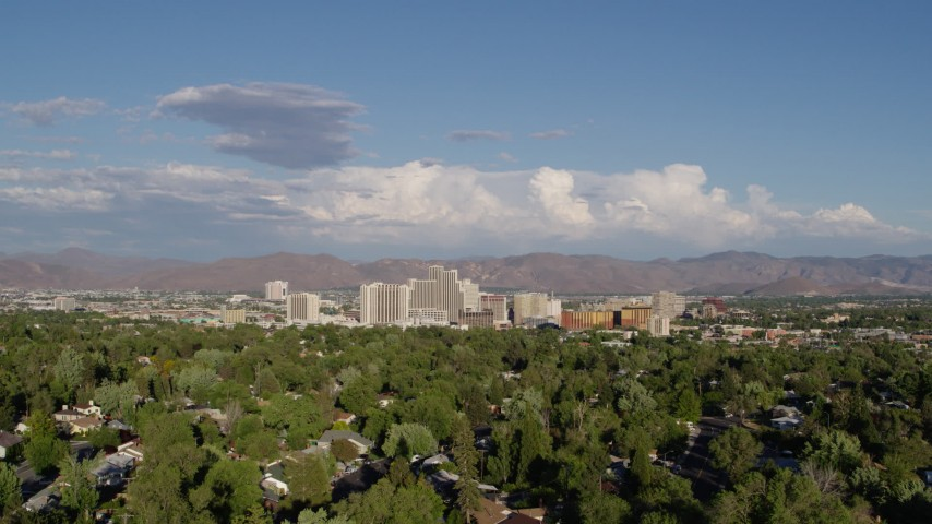 5.7K stock footage aerial video of ascending from Lake Park to reveal the city skyline in Reno, Nevada Aerial Stock Footage | DX0001_000068