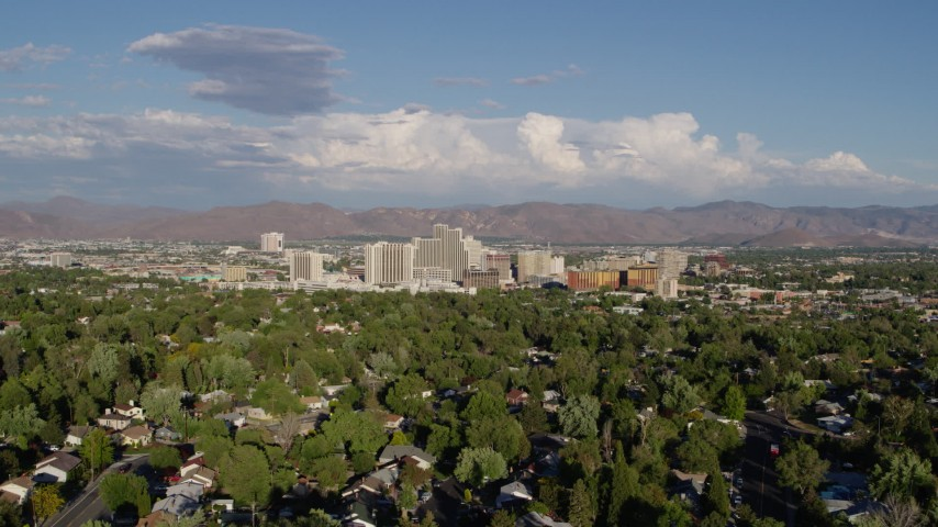 5.7K stock footage aerial video of a view of the city skyline from tree-lined neighborhoods in Reno, Nevada Aerial Stock Footage | DX0001_000069
