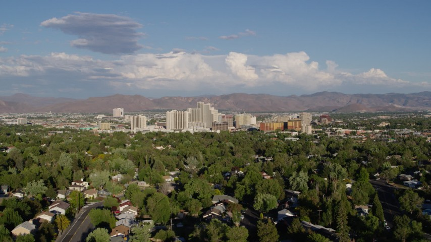 5.7K stock footage aerial video of the city skyline seen from tree-lined neighborhoods in Reno, Nevada Aerial Stock Footage | DX0001_000070