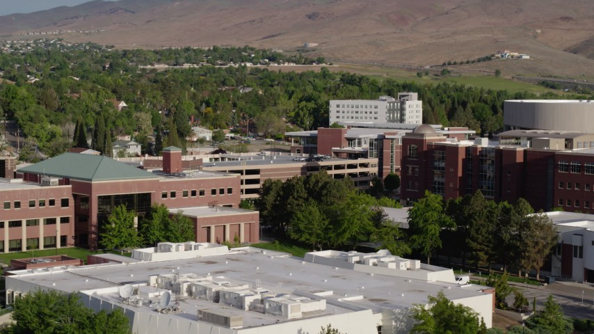 5.7K stock footage aerial video of passing the campus of the University of Nevada in Reno, Nevada Aerial Stock Footage | DX0001_000078