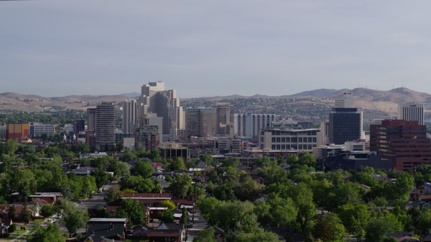5.7K stock footage aerial video of slowly passing by office buildings, resort casinos and hotels in Reno, Nevada Aerial Stock Footage | DX0001_000081