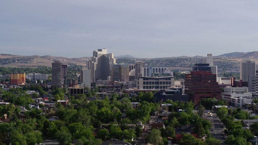 5.7K stock footage aerial video of slowly flying by office buildings, resort casinos and hotels in Reno, Nevada Aerial Stock Footage | DX0001_000082