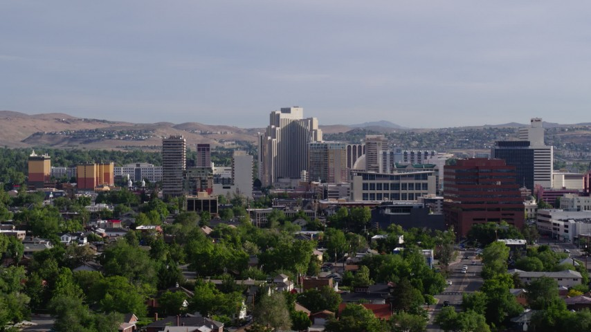 5.7K aerial video of casino resorts and office buildings seen from neighborhoods in Reno, Nevada Aerial Stock Footage | DX0001_000085