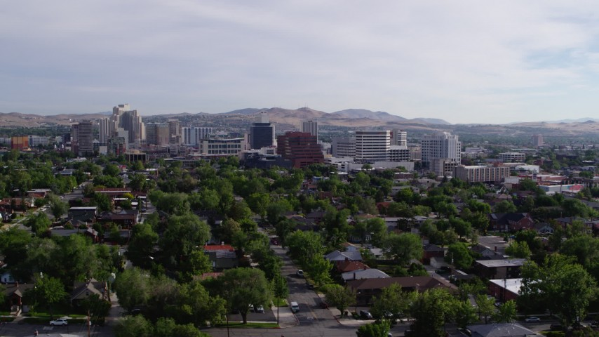 5.7K stock footage aerial video of a view of casino resorts and office buildings seen from neighborhood with trees in Reno, Nevada Aerial Stock Footage | DX0001_000087