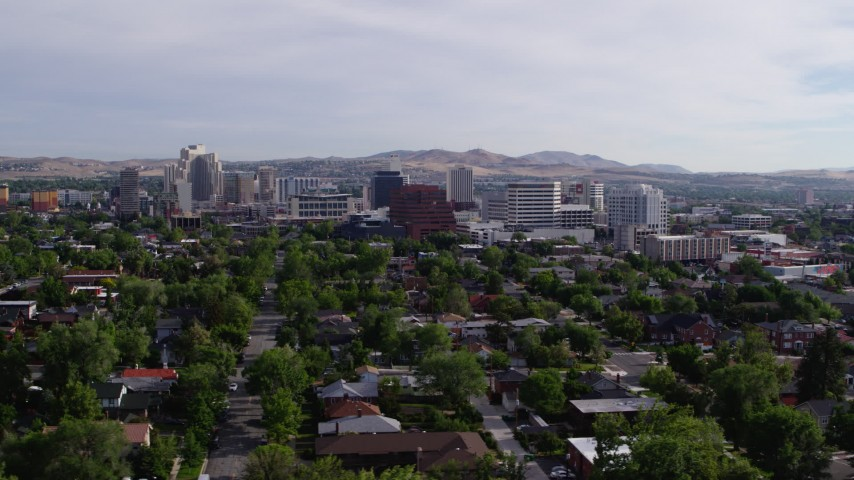 5.7K stock footage aerial video of casino resorts and office buildings seen from neighborhood with trees in Reno, Nevada Aerial Stock Footage   DX0001_000088