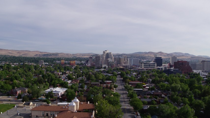 5.7K stock footage aerial video flyby casino resorts and office buildings seen from suburban neighborhood in Reno, Nevada Aerial Stock Footage | DX0001_000090