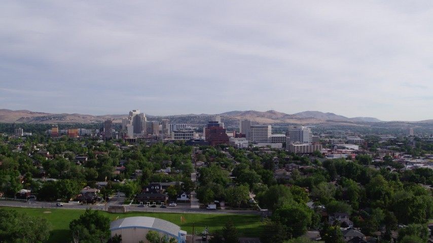 5.7K aerial video approach casino resorts and office buildings from neighborhood in Reno, Nevada Aerial Stock Footage | DX0001_000092