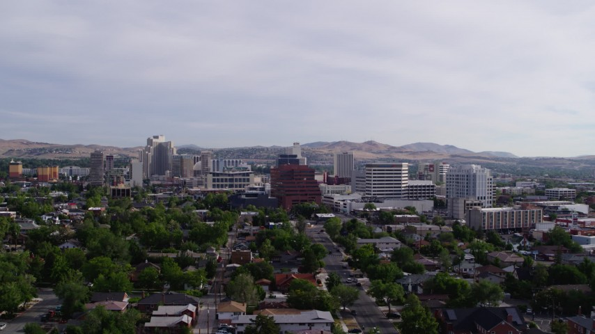 5.7K stock footage aerial video fly away from casino resorts and office buildings in Reno, Nevada Aerial Stock Footage | DX0001_000093