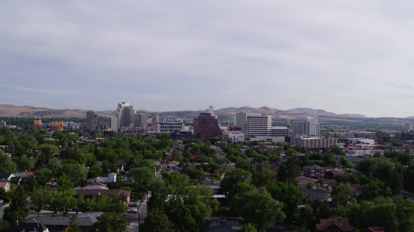 5.7K stock footage aerial video descending from a view of casino resorts and office buildings in Reno, Nevada Aerial Stock Footage | DX0001_000094
