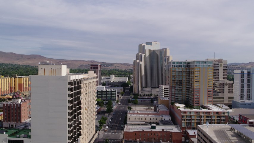 5.7K stock footage aerial video of the Silver Legacy Resort seen while passing the Plaza Resort Club in Reno, Nevada Aerial Stock Footage | DX0001_000096