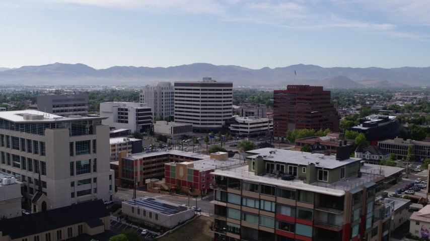 5.7K stock footage aerial video of passing by the city's office buildings in Reno, Nevada Aerial Stock Footage | DX0001_000107