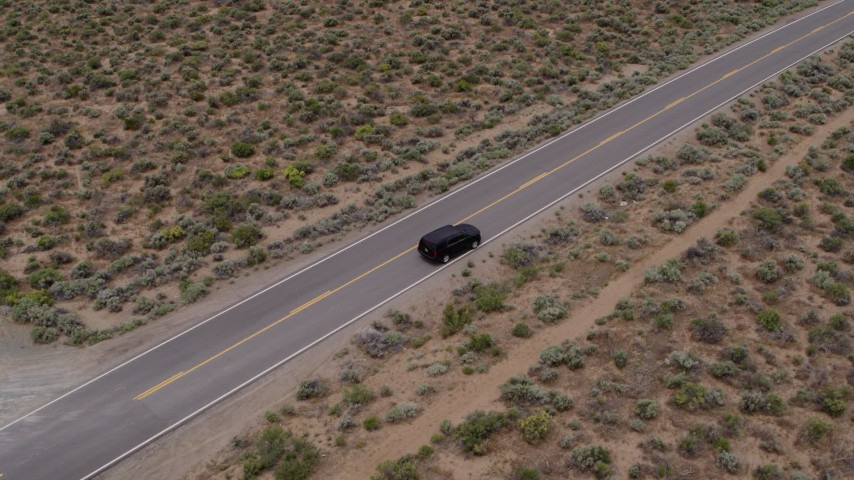 5.7K stock footage aerial video approach a black SUV parked on a desert road in Carson City, Nevada Aerial Stock Footage | DX0001_000128