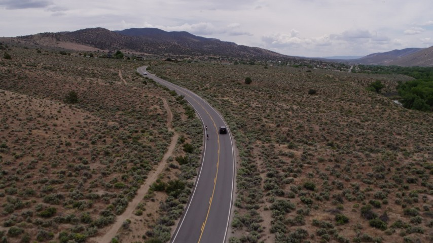 5.7K stock footage aerial video of a black SUV cruising on a desert road in Carson City, Nevada Aerial Stock Footage DX0001_000135 | Axiom Images