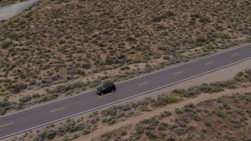 5.7K stock footage aerial video of a black SUV driving on a desert road in Carson City, Nevada Aerial Stock Footage | DX0001_000137