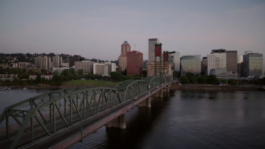 4K stock footage aerial video of Hawthorne Bridge spanning the Willamette River at sunrise, Downtown Portland, Oregon Aerial Stock Footage | DX0001_000165