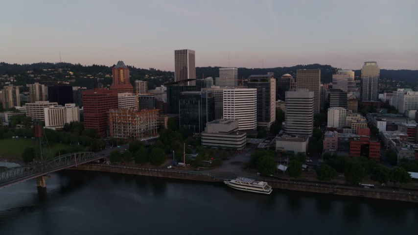 4K stock footage aerial video flying by the downtown skyline, Hawthorne Bridge at sunrise, Downtown Portland, Oregon Aerial Stock Footage | DX0001_000168