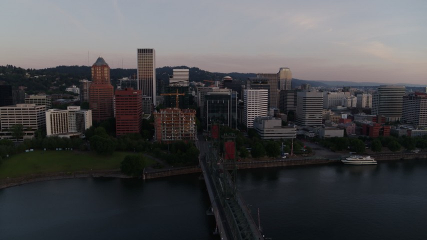 4K stock footage aerial video flying by downtown, over the Hawthorne Bridge at sunrise, Downtown Portland, Oregon Aerial Stock Footage | DX0001_000169