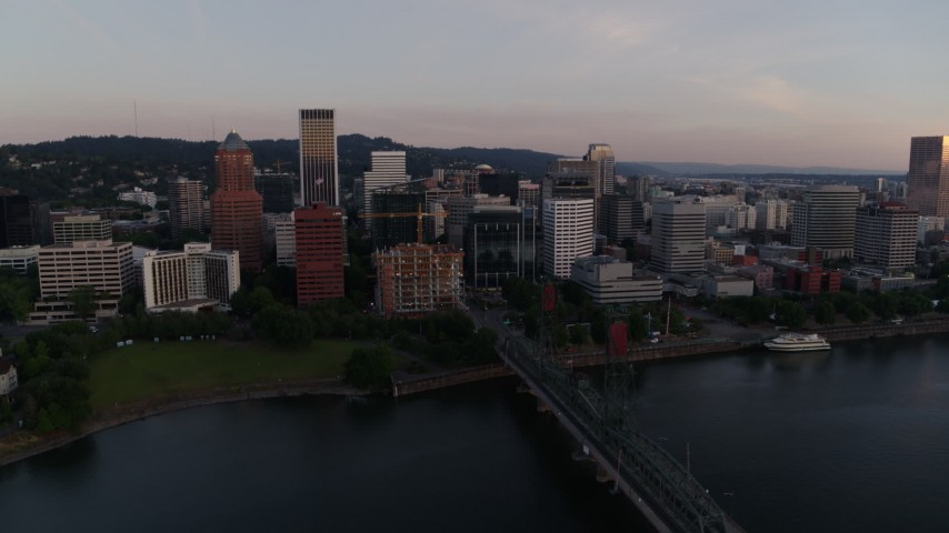 4K stock footage aerial video of downtown buildings and the Hawthorne Bridge at sunrise, Downtown Portland, Oregon Aerial Stock Footage | DX0001_000170