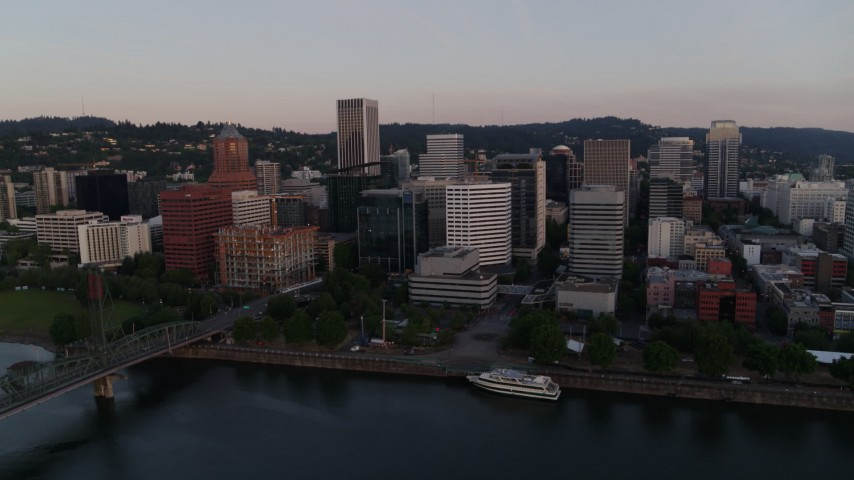4K stock footage aerial video of the downtown skyline and Hawthorne Bridge at sunrise, Downtown Portland, Oregon Aerial Stock Footage | DX0001_000171