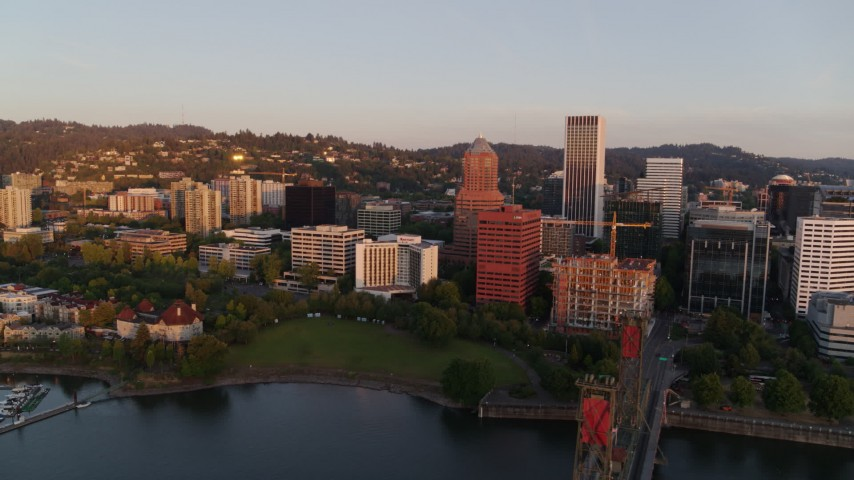 4K stock footage aerial video flying by downtown near Riverplace Marina at sunrise, Downtown Portland, Oregon Aerial Stock Footage | DX0001_000178