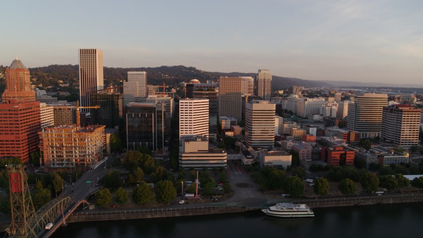 4K stock footage aerial video flying over Hawthorne Bridge at sunrise, approaching Downtown Portland, Oregon Aerial Stock Footage | DX0001_000179