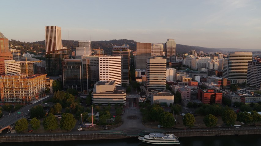 4K stock footage aerial video of downtown office buildings and skyscrapers at sunrise, Downtown Portland, Oregon Aerial Stock Footage | DX0001_000180