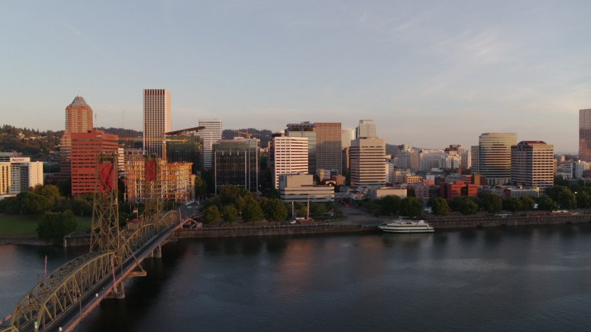 4K stock footage aerial video descending near Hawthorne Bridge at sunrise with views of Downtown Portland, Oregon Aerial Stock Footage DX0001_000182 | Axiom Images