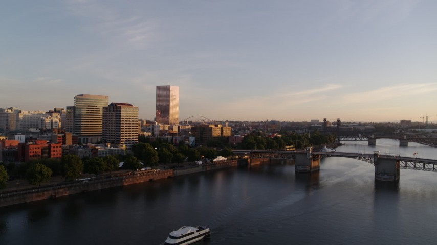 4K stock footage aerial video approaching the Morrison Bridge spanning Willamette River near Downtown Portland, Oregon Aerial Stock Footage DX0001_000183