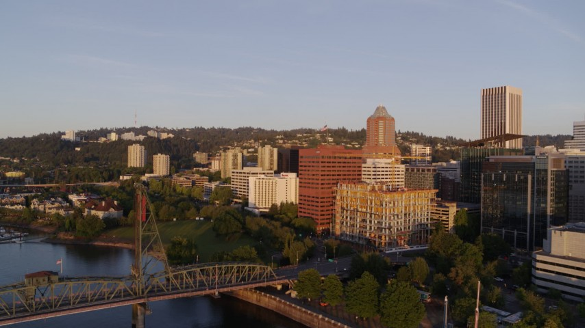 4K stock footage aerial video approaching Hawthorne Bridge at sunrise in Downtown Portland, Oregon Aerial Stock Footage | DX0001_000184