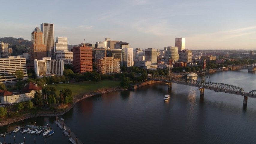 4K stock footage aerial video flying by Riverplace Marina, approaching Hawthorne Bridge and Downtown Portland, sunrise, Oregon Aerial Stock Footage | DX0001_000186