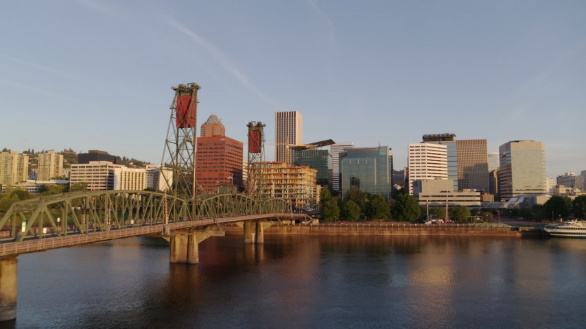 4K aerial video flying over Hawthorne Bridge, approaching waterfront park and Downtown Portland, Oregon at sunrise Aerial Stock Footage | DX0001_000187